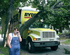 The unidentified driver of this rental truck makes a phone call after she hit this 30 year old Norway Maple tree on Cottage Street in Lewiston.
