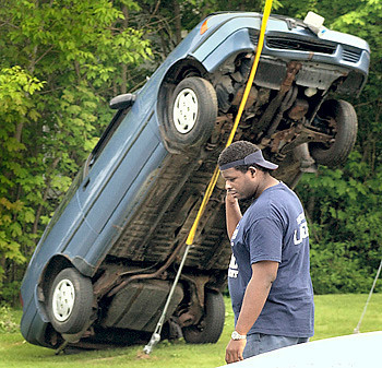 Habean Mabin walks by the vehicle he was in the back seat of when it went out of control and climbed up a guy wire on a telephone pole on Vale Street in Lewiston between Sabattus Street and Central Avenue.