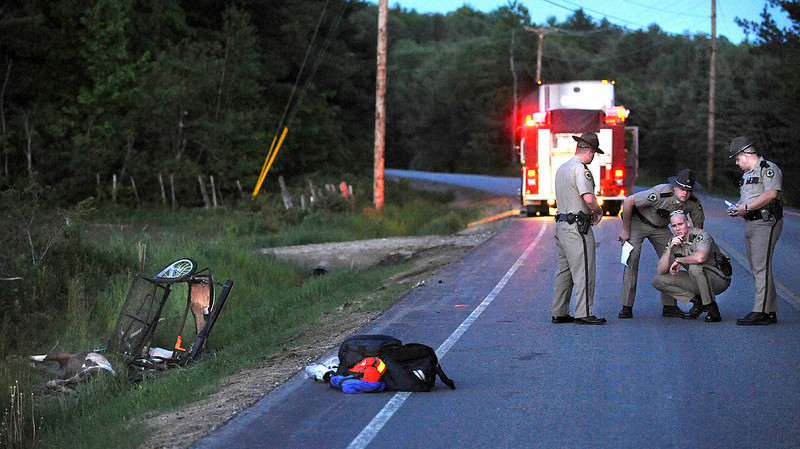 Oxford County Sheriff Officers investigate the scene of an accident on Route 117 in Buckfield  where a truck hit a horse drawn wagon.