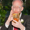John drinking champagne from the glass boot