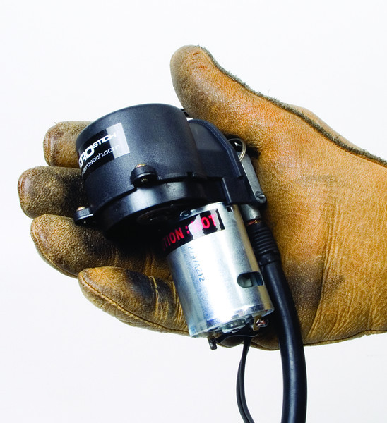 """This is the smallest, lightest compressor we carry and one of the most efficient you'll find for its size. This stripped-down mini fits in the palm of your hand and will inflate any motorcycle tire in a couple minutes. When a larger compressor is too much bulk to carry along, and CO2 cartridges aren't nearly enough for your trip, this dedicated pump will deliver continuous pressure without fail. What it lacks in beauty, it makes up for in performance – which is what you really need when you're flat stranded in the middle of nowhere. Has a nice long 26"""" inflator hose, 6' power cord, and packs small in included storage sack. Comes with three adaptors: SAE, cigarette lighter and alligator clips. Lock-down delivery valve fits all bikes. Also comes with carabiner clip, so you can attach the compressor to whatever you want out of the way and off the ground, instead of having it lay in the mud or dirt. Simple, compact, and dependable piece of mind. Pump is 3.5""""×3.5""""×.9"""". Packs to 7""""×5""""×3"""". 1.3 lbs<br /> <br /> #3500      $47.00"""