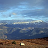 Morocco, Africa. A Landrover crosses the Atlas Mountains in winter.