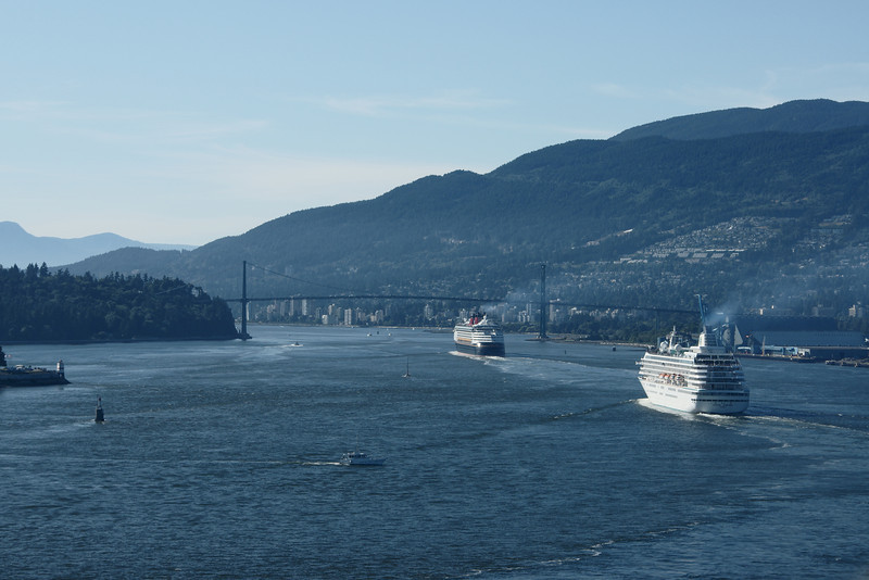 Cruise ships depart Vancouver for Alaska about to pass under Lions Gate Bridge.