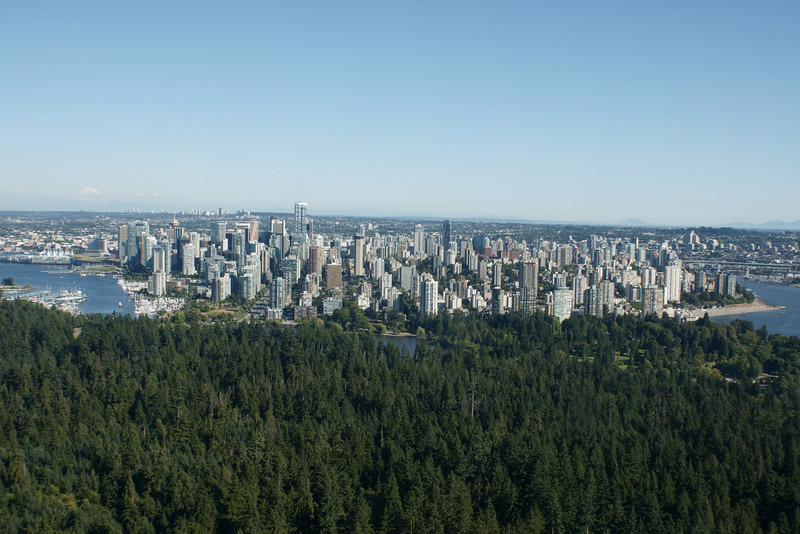 Downtown Vancouver with Stanley Park in the foreground from the air.
