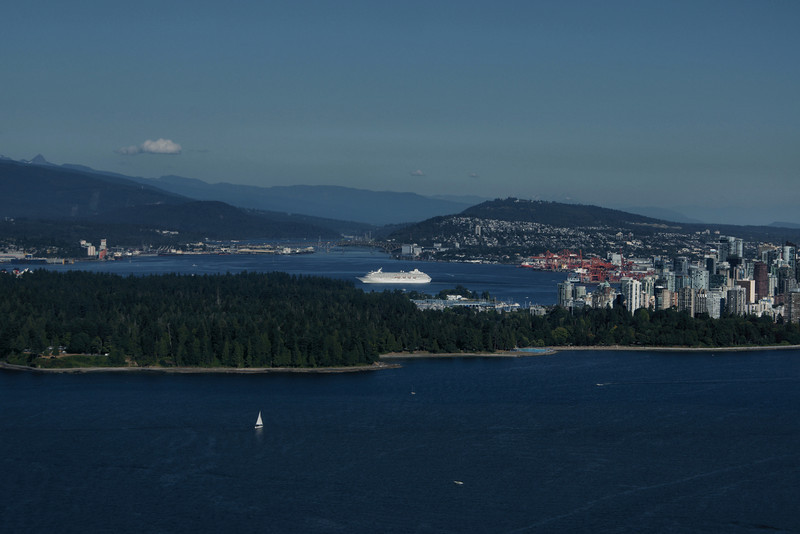 Cruise ship leaving Vancouver for Alaska with Stanley Park in the foreground and downtown Vancouver in the background