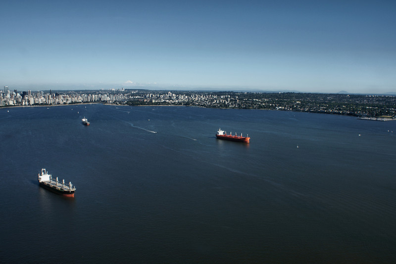 Freighters at anchor in English Bay Vancouver BC as seen from the air.