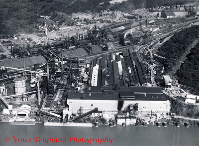 Weirton Steel Company in Weirton, WV - 1983.  In the foreground is the Ohio River, the Continuous Anneal in the rear of the Tin Mill, on the left is the old Coke Plant, in the middle are the Blast Furnaces, to the right is the old Blooming Mill and Open Hearth, and in the right rear is the BOP.