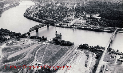 Early construction phase of the Veteran's Memorial Bridge looking toward Steubenville, Ohio. The bridge on the right is the Fort Steuben Bridge and the bridge on the left is the Conrail Train Bridge - 1983