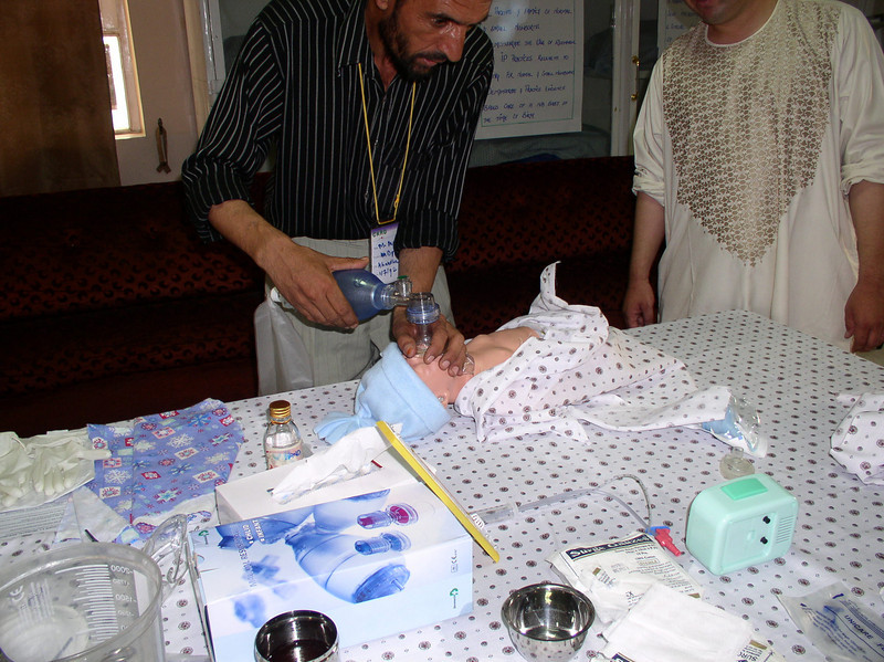 Pediatrician practicing bag and mask ventilation