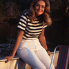 Gail Roher poses aboard boat on river in Zambia.