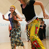 Nicole Cassidy and Elise Gent demonstrate at African dance on Saturday, December 11, 2010 at the Railyard Performance Center.<br /> Gent has a major following with her African dance class.  It runs from 11:30-1 p.m. every Saturday.<br /> Photos by jane Phillips/The New Mexican