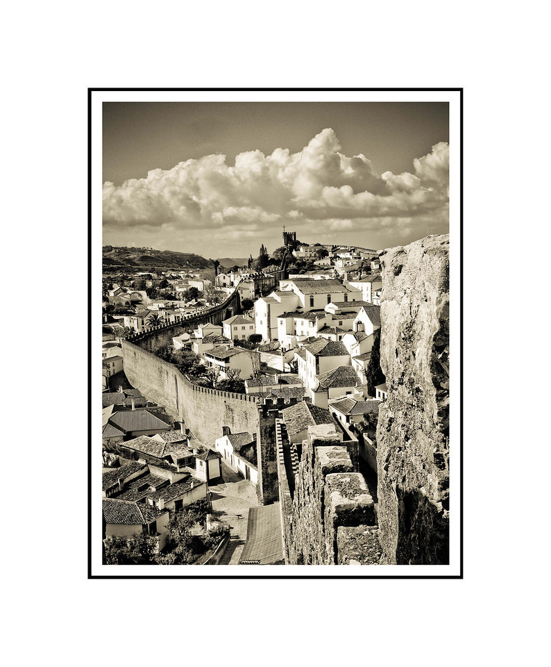 """Walled Town of Obidos""<br /> <br /> Photograph: 8""x10.66"" archival gelatin silver print<br /> Frame: 16""x20"" white matte w/ black core, black metal frame"