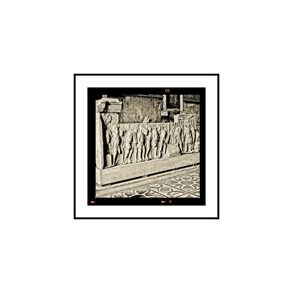 """Bas Relief - The Forum""<br /> <br /> Photograph: 2.5""x2.5"" archival gelatin silver print<br /> Frame: 10.5""x10.5"" white matte w/ black core, black metal frame"
