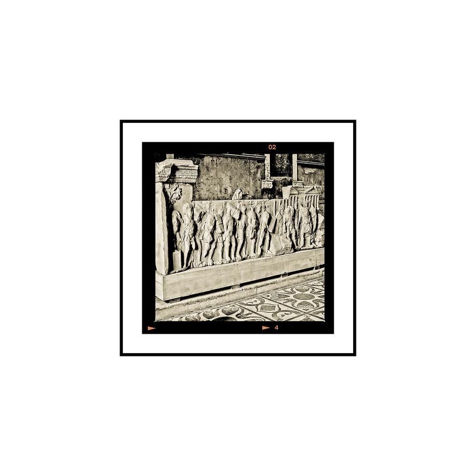 """Bas Relief - The Forum""<br /> <br /> Photograph: 2.5""x2.5"" archival gelatin silver print<br /> Frame: 10.5""x10.5"" white matte w/ black core, black metal frame"