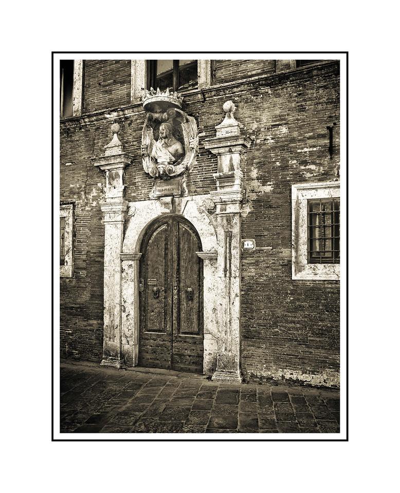 """Door - Montepulciano""<br /> <br /> Photograph: 11""x14.66"" archival gelatin silver print<br /> Frame: 18""x24"" white matte w/ black core, black metal frame"