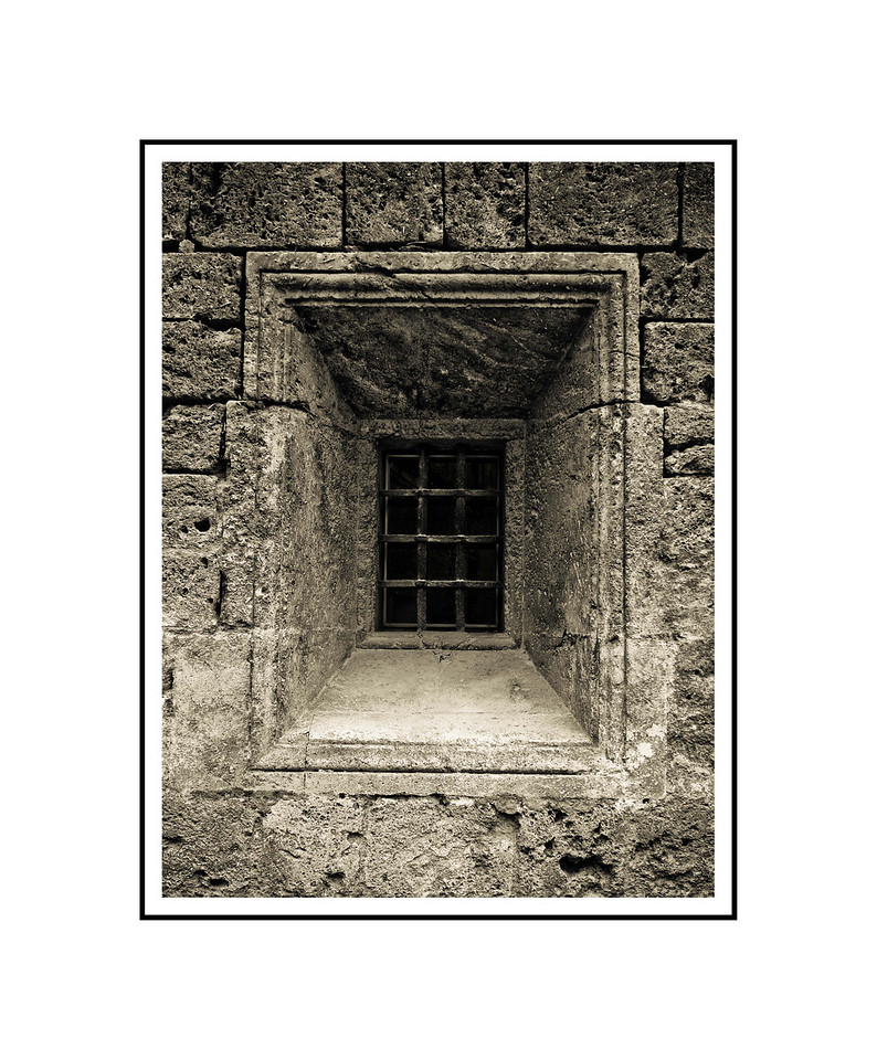 """Barred Window - Granada""<br /> <br /> Photograph: 8""x10.66"" archival gelatin silver print<br /> Frame: 16""x20"" white matte w/ black core, black metal frame"