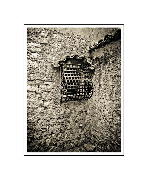 """Iron Window - France""<br /> <br /> Photograph: 8""x10.66"" archival gelatin silver print<br /> Frame: 16""x20"" white matte w/ black core, black metal frame"