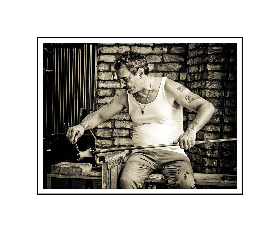 """Glass Artist - Murano""<br /> <br /> Photograph: 10.66""x8"" archival gelatin silver print<br /> Frame: 20""x16"" white matte w/ black core, black metal frame"