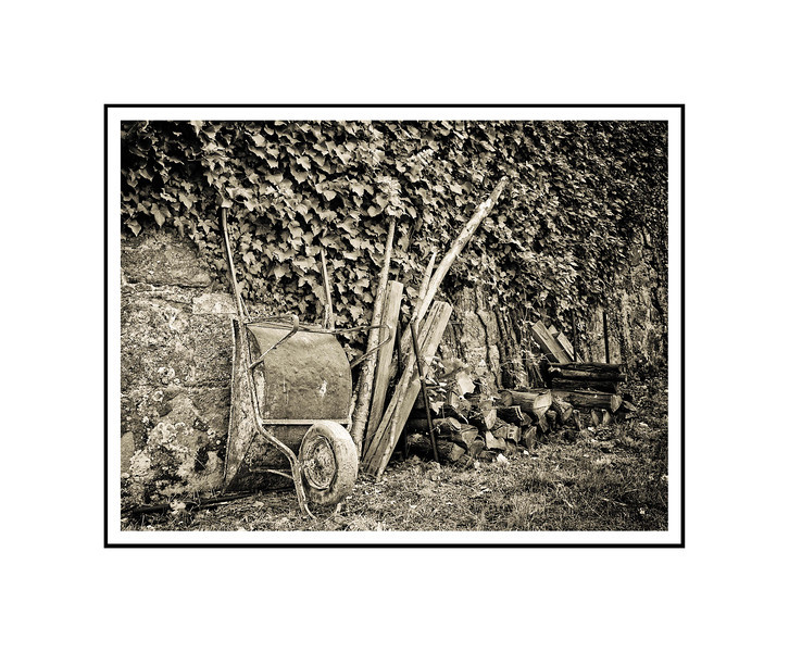"""Wheelbarrow and Wood""<br /> <br /> Photograph: 10.66""x8"" archival gelatin silver print<br /> Frame: 20""x16"" white matte w/ black core, black metal frame"