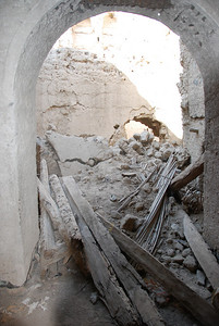 The crumbling debris inside one of the houses in Al Munisifeh.