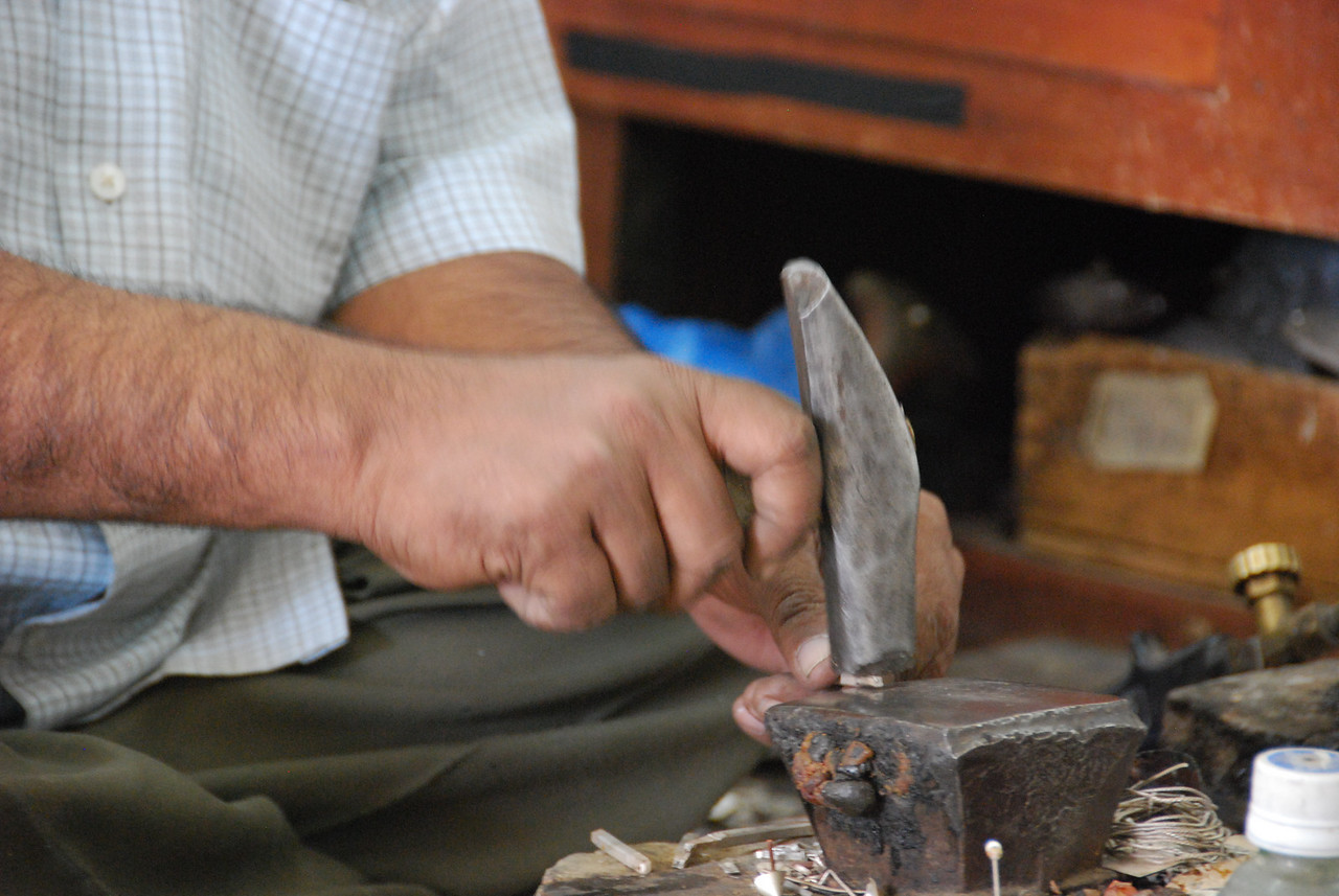 Silversmith at work in Sinaw Souq.
