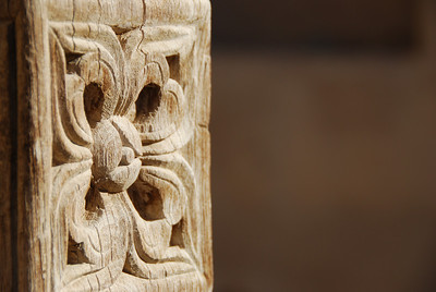 Carving in a door leading to one of the abandoned houses.