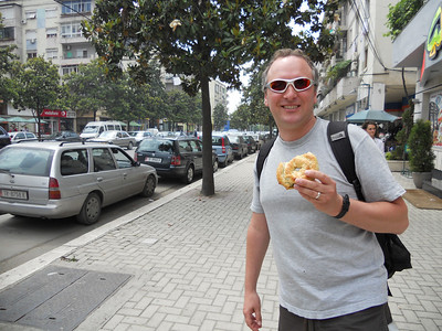 Sampling a spinach filled pastry - a local speciality.