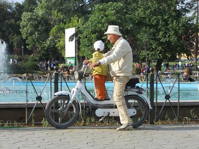 Random grandad takes grandson round the park. No seat, no helmet. Albania style.