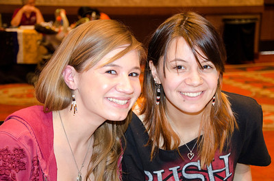 Sisters Bethany and Emma Cohnheim model the beaded earrings they made during the Choctaw Nation cultural meeting in Albuquerque.