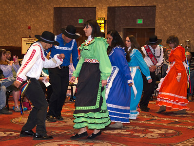 A group of Choctaw Nation employees show how to do the Four-Step War Dance.