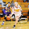 Alexandria's Kelsey Crisp brings the ball down court as the Tigers hosted the Marion Giants on Wednesday.