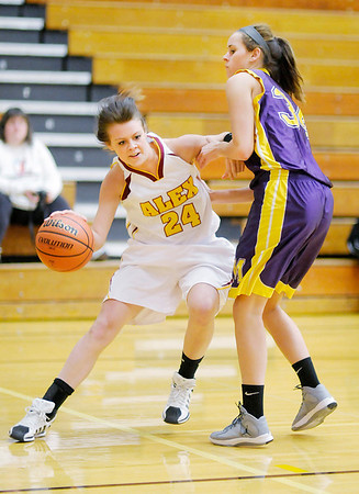 Alexandria's Paxton Quinn drives into the low post against Marion's Hannah Conrad on Wednesday.