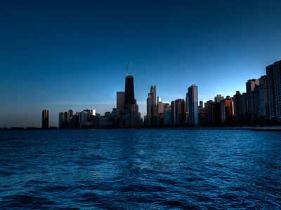 The chicago skyline in the sunset.