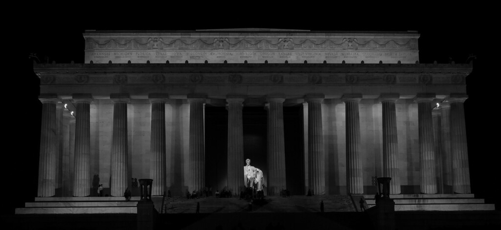 A hand held (yes, at 1/5s) image of the Lincoln Memorial at night.  I used a blue B&W filter to adjust the light levels