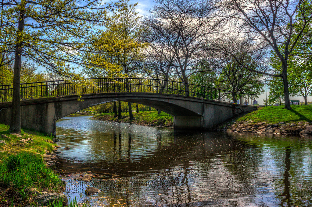 A nice little bridge over a creek in Boston.  I used an HDR on this, but kept this really natural to bring out the reflections in the water.