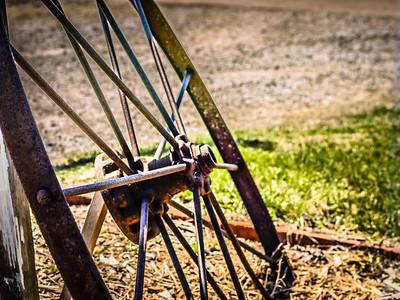 Old rusted wheel buried near Aledo, Illinois
