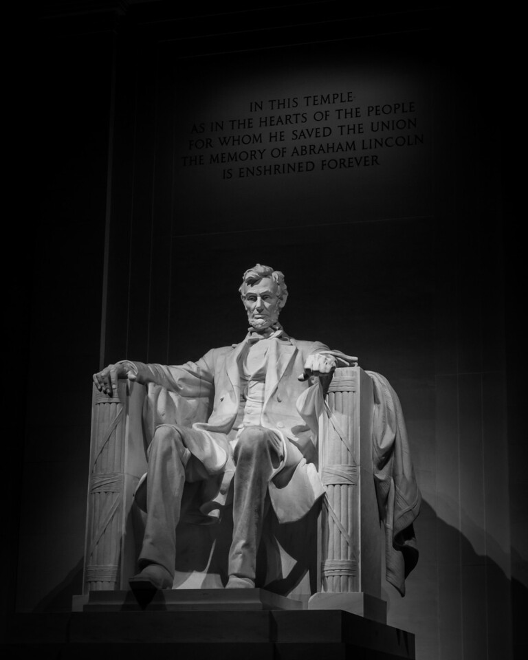 This is a night time shot of the Lincoln Memorial with my camera held up against the column to make it table.  Played with the colors in the Black  & White to get the background at just the right light level.