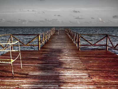 Took a photo of this bridge in Playa del Carmen.  Debated whether to edit out the yellow tape to mark the bad areas of the dock....decided against it.