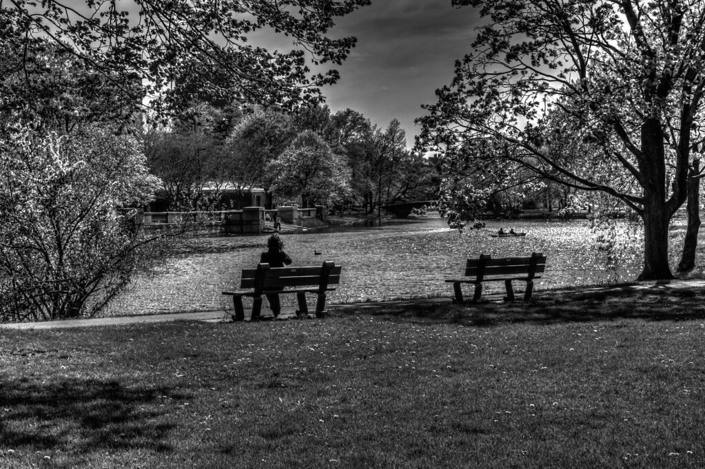 A nice black and white of relaxing on the bench