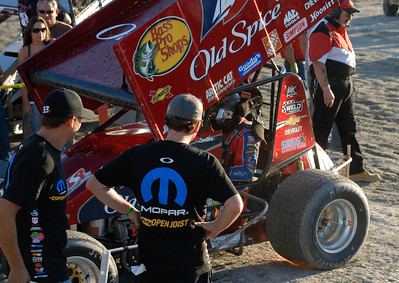 Tony Stewart at Kasey Kahne Foundation Sprint car race, August 2007. I love this picture because you can see the flames coming out of the exhaust under the tire!