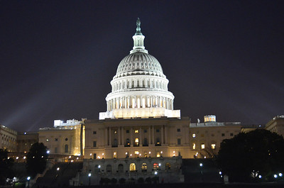 U.S. Capitol, illuminated at night. There was some cleanup work being done at the bottom of the dome. March 2012