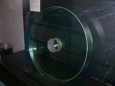 This is the original 31 inch plate glass mirror of the James Keeler Memorial Telescope. The optics were made by John A. Brashear. It is interesting to note that the wide use of natural gas in the glass industries of the late 1800's led to the production of very pure, tough and well annealed plate glass. In reducing tempeture of the annealing ovens the gas by its continous flow Brashear was able to complete a glass works for experiments in optical glass. Natural gas was used throught his oven and an automatic cut-off governed the annealing temperature.
