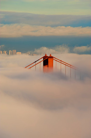 Towers on the Golden Gate Bridge peeking through the fog, San Francisco