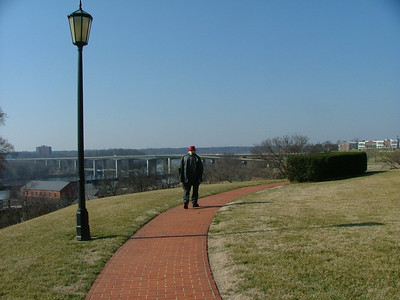 "Al on the walkway on Gambell's hill. He remembers ""Mr. Mac""'s bench about here. A bald retiree with a railroad watch."