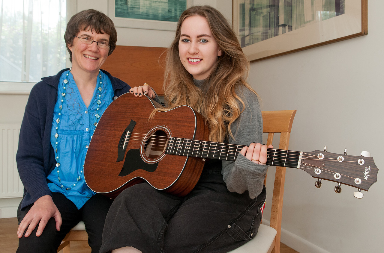 19 year old Charlotte Foley plays her guitar and sings for mother Jane Launchbury at their home in Downton, Wiltshire. 5th July, 2016 - Picture Andy Brooks
