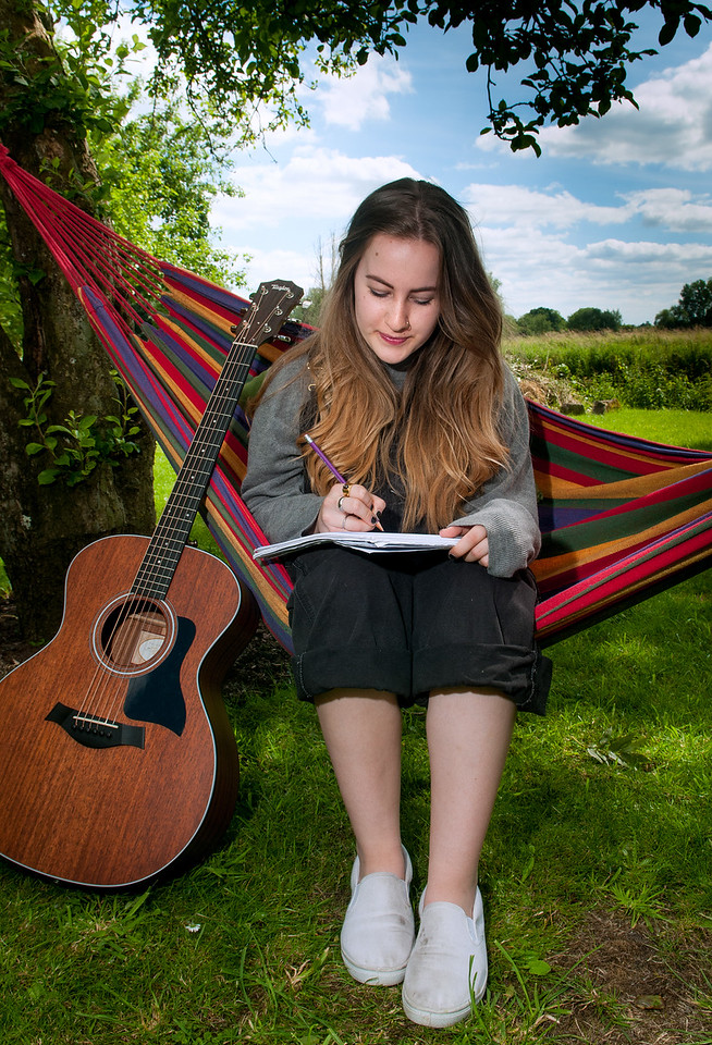 19 year old Charlotte Foley working on one of the many songs she writes and performs in the garden of her home in Downton, Wiltshire. 5th July, 2016 - Picture Andy Brooks