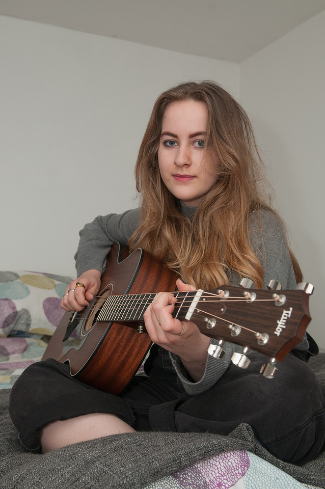 19 year old Charlotte Foley plays her guitar in her bedroom. 5th July, 2016 - Picture Andy Brooks