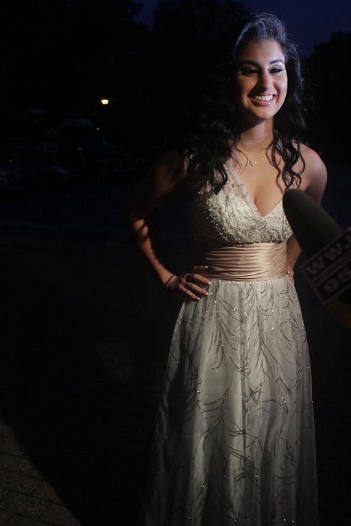 . Jena Irene Asciutto shows off the dress she wore to North Farmington High School\'s prom. Erin Hampton - Special to The Oakland Press