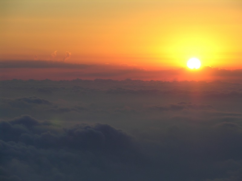 As the sun was setting, we began our descent through the cloud layer.