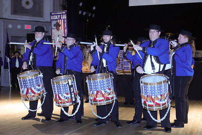 American Originals Fife and Drum Corps drummers show off their fancy drum stick moves at the Friday Night Patriotic Concert. Wicked Local Photo/Denise Maccaferri